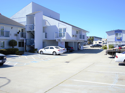 Welcome To The SAND DOLLAR INN - Exterior View Of Hotel